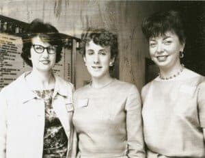 Society of Women Engineers Lillian Moller Gilbreth Scholarship recipients Eliz Hinton, Valerie Peterson, and Phyllis Gaylard stand in the registration area for the First International Conference of Women Engineers and Scientists in New York City, June 1964.