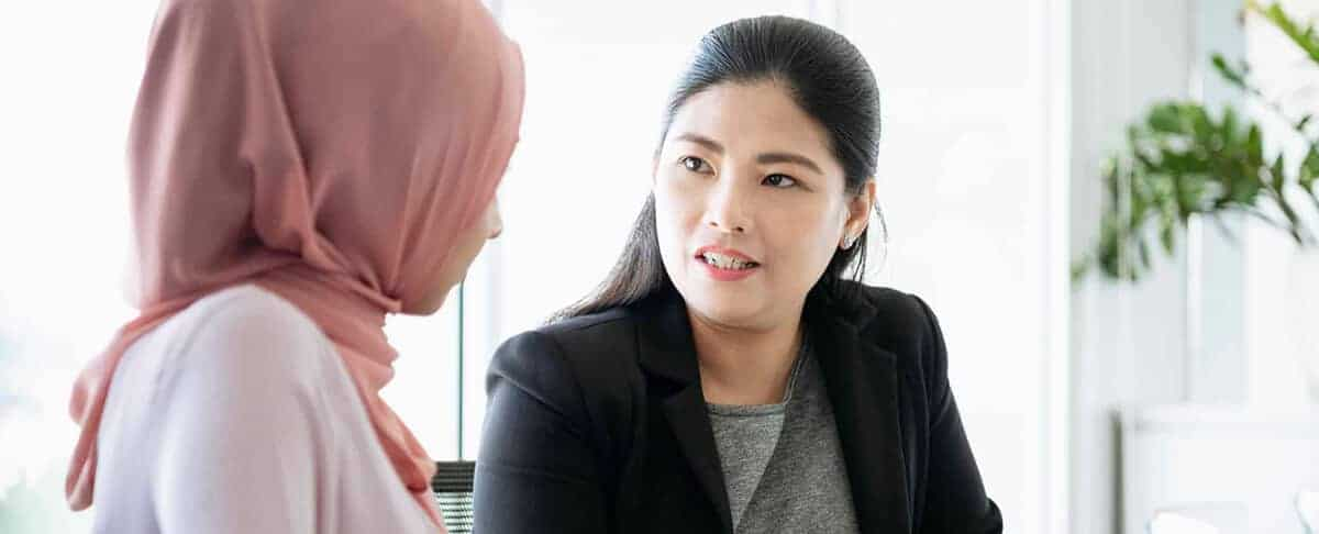 Mature woman listening to female colleague