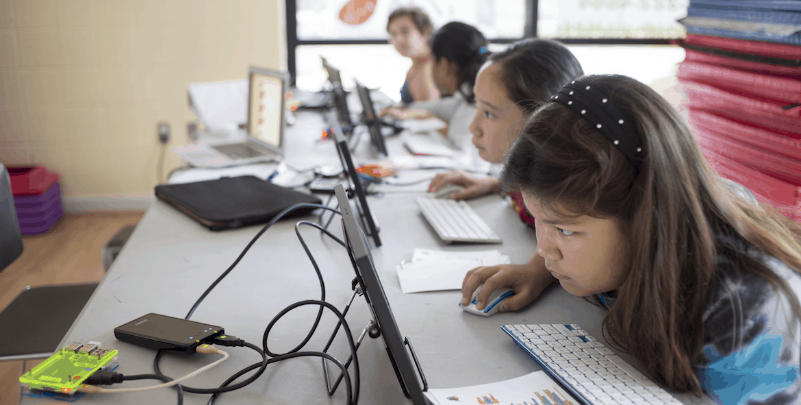 Young girls learning to code