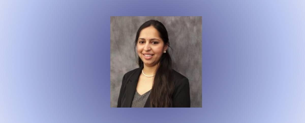 headshot of Kalyani Mallela on purple gradient background