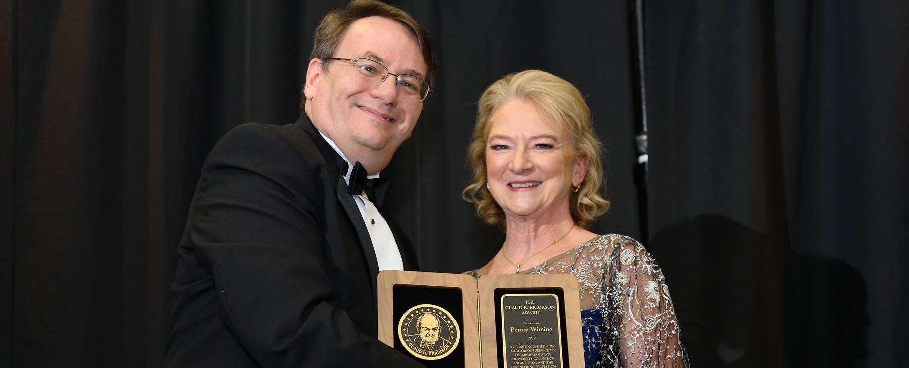 Penny Wirsing holding MSU distinguished alumni award