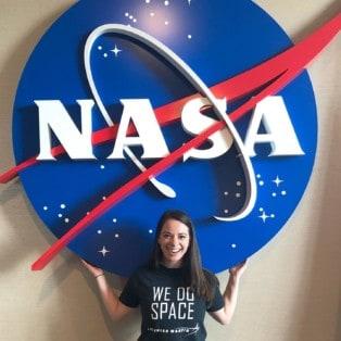 Renee Frohnert below NASA signage