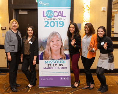 Trenyce McCoy and fellow SWE staff at a WE Local conference