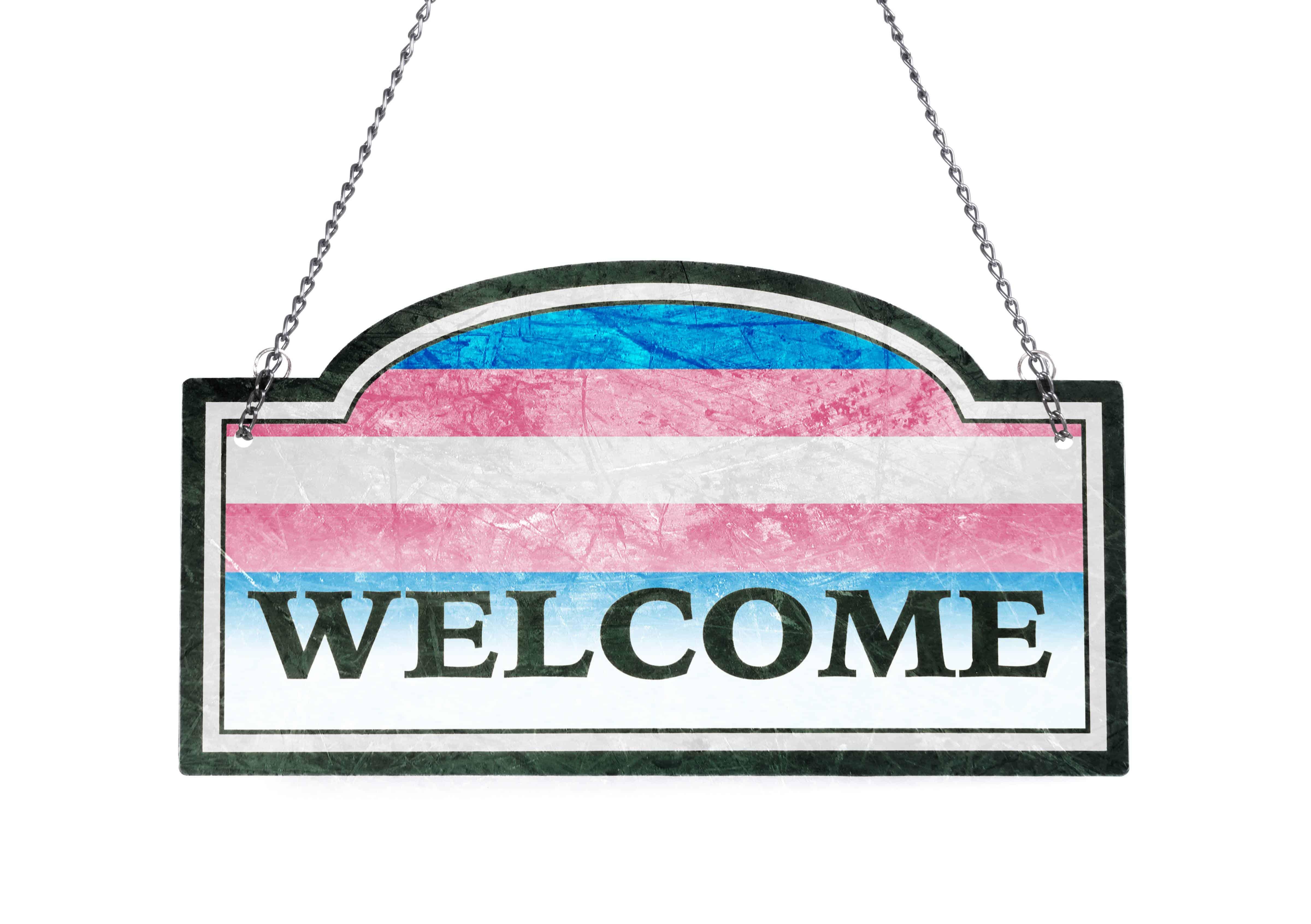 Welcome sign with transgender flag background - transgender inclusion