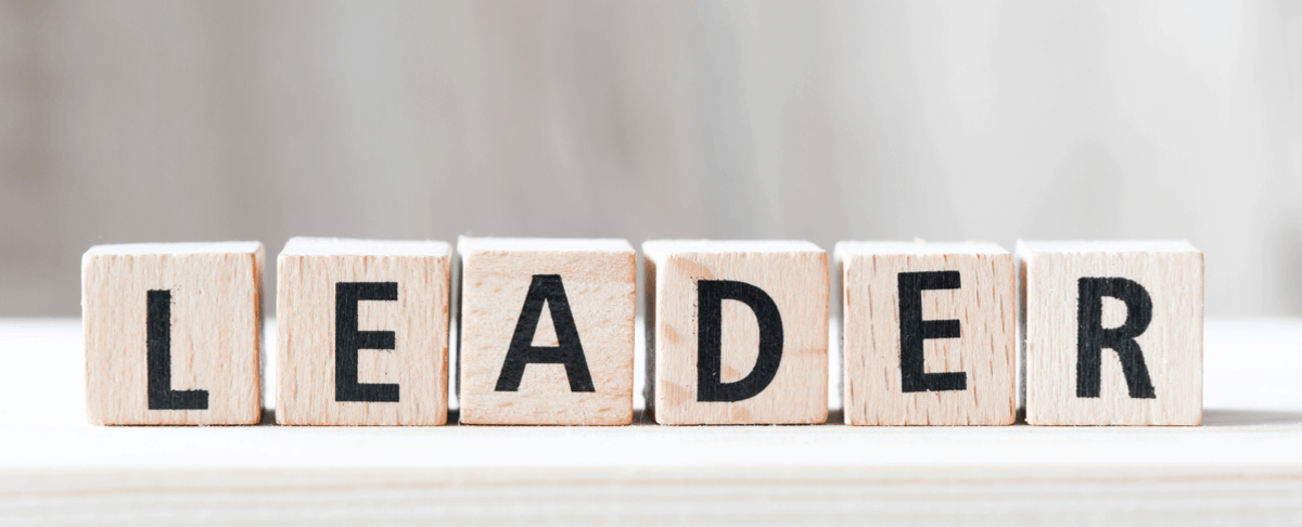 scrabble tiles spelling out 'leader'