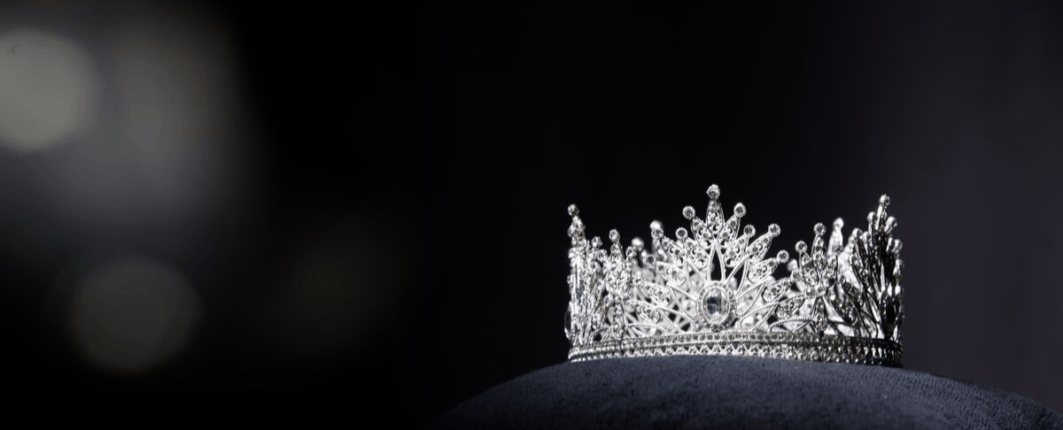 image of jeweled crown or tiara on pillow