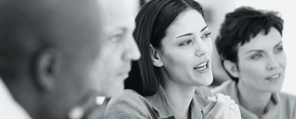 image of woman speaking in group setting