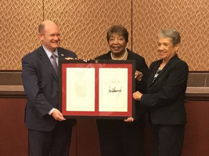 Senator Chris Coons (D-DL) and Chairwoman Eddie Bernice Johnson (D-TX) award Dr. Christine Darden.