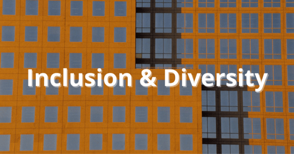 inclusion and diversity words over brown and gold building
