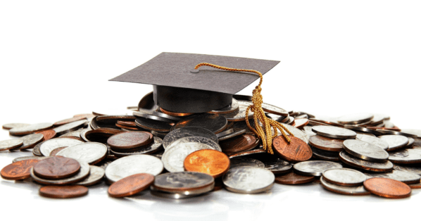 grad school funding - graduation cap on top of coins