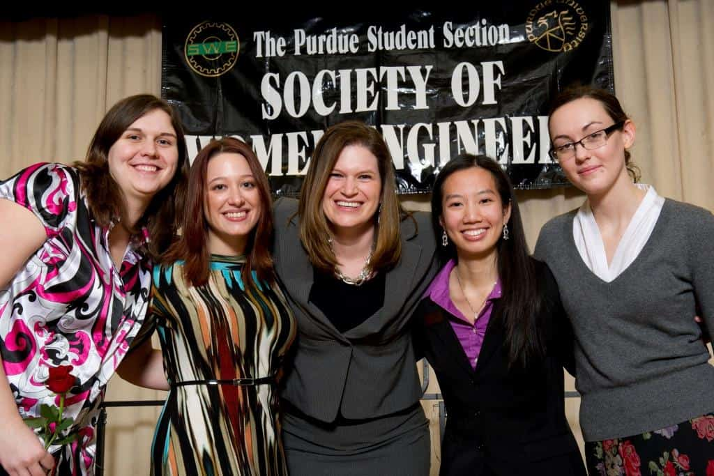 Beth Holloway, center, shares a celebratory moment with the Purdue University SWE officers.